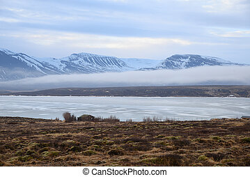 low fog cover snow mountain area in iceland