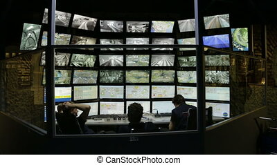 security guards watching video monitoring security system