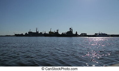 Silhouette row of warships in the Bay of Kronstadt