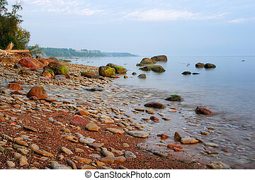 Brink - Rocky sea shore with a mass of large boulders