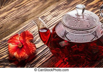 Hibiscus tea rosella - Hibiscus tea in transaprent teapot on...