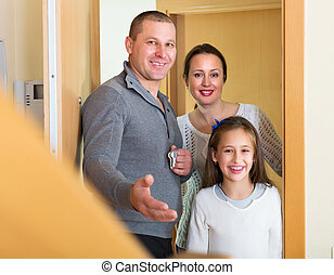 Family coming inside mortgage house - Husband, wife and...