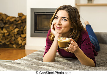 Capuchino Time - Beautiful woman at home drinking a...