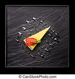 Cheese cake on black plate - Slice of cheese cake with...