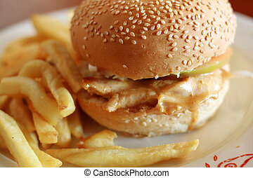 chicken burger - a delicous chicken burger and chips on a...