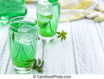Cold beverage with Woodruff taste in a glass