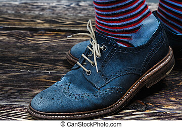 Blue suede shoes - Close up of men's brogues (also known as...