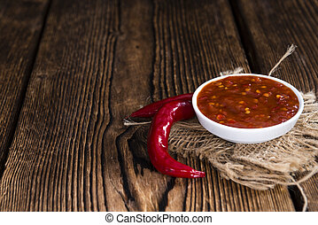 Fresh made Chili Sauce (Sambal Oelek) on rustic wood