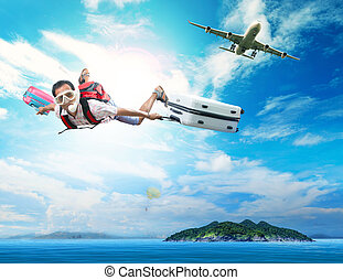 young man flying on blue sky wearing snorkeling mask and...
