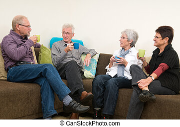Coffee Time - Group of four seniors drinking coffee,...