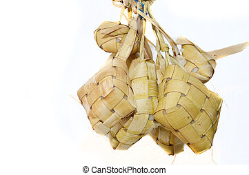 ketupat, indonesian traditonal food isolated on white...