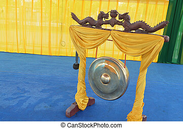 gong - traditional golden gong with dragon ornaments