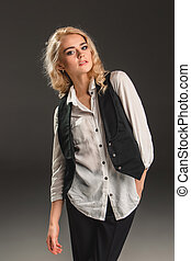 Beauty blond woman on a gray background - Beauty blond woman...