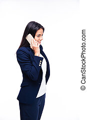 Happy businesswoman talking on the phone and looking away....