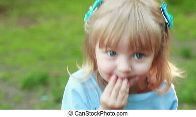 Girl sucking hand on nature - Near fire picnic girl child...