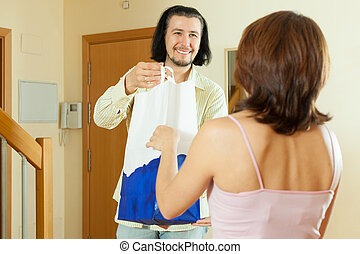 man is giving beautiful woman a gift at home - Handsome man...