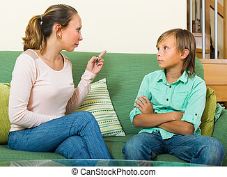 Mother scolding teenage son
