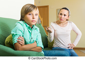 Mother and son having quarrel - Mature mother and teenager...