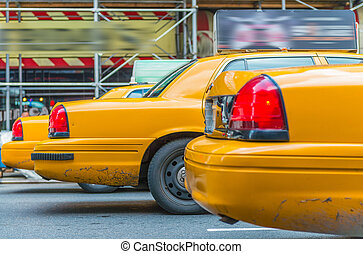 Lined up Yellow Cabs in New York avenue.