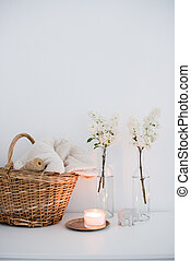 room interior decoration - Wicker basket with home textiles...