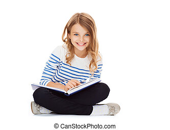 girl reading book - education and school concept - little...