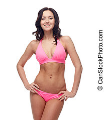 happy young woman in pink bikini swimsuit - people, fashion,...