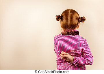 Portrait of cute elegant redhead girl from back with crossed...