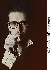 Man in glasses with cigarette