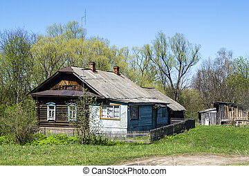 Farmhouse on background blue sky in Russia