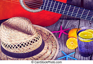 Acoustic guitar hat starfish and glass of tasty fresh...
