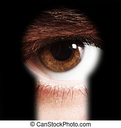 male eye spying through a keyhole - Scared male eye spying...