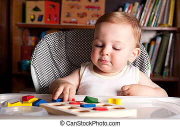 Boy and colorful toy blocks