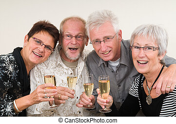 Happy New Year - Two senior couples toasting on a Happy New...