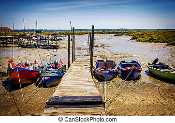 Moored Fishing Boats - Row of fishing boats moored in a dry...