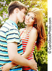 amorousness - Beautiful young couple in love in a summer...