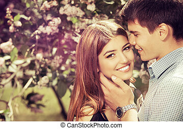 sincere - Romantic young people tenderly kissing in the...