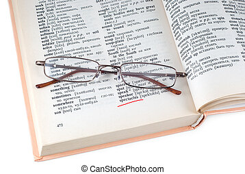 The dictionary and spectacles - Spectacleses lay on the...