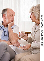 Asking husband about taking medicines - Elder woman asking...