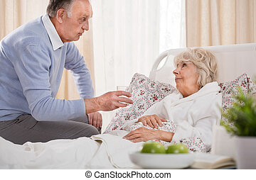 Husband caring about ill wife