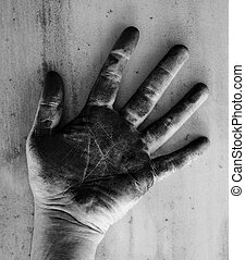 Left hand of a man dirty of charcoal