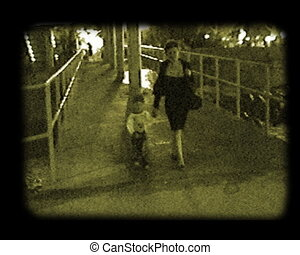 scene at the nightly sea beach - mother and child walking at...