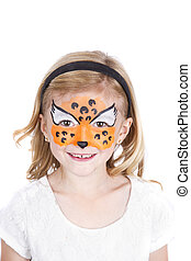 Young girl wearing cheetah carnival face paint isolated on...