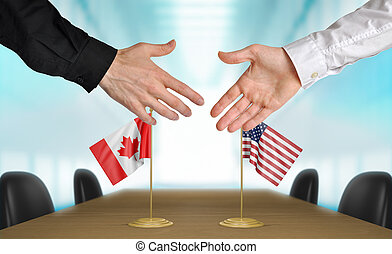 United States and Canada diplomats agreeing on a deal.