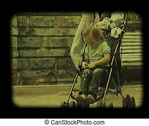 child at the carriage - little girl sitting at the carriage...