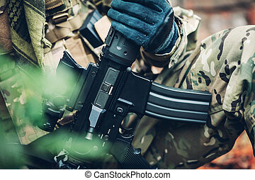 soldier holding weapon M4 carbine - soldier holding modern...