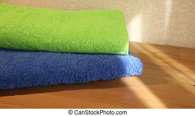 Blue and green towels - Sliding view of blue and green...