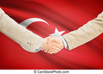 Businessmen handshake with flag on background - Turkey -...