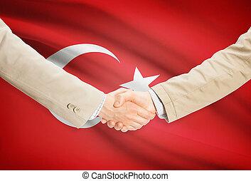 Businessmen handshake with flag on background - Turkey -...