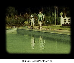 scene at the pool - mother and daughter walking at pool...