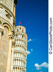 Leaning tower behind the Baptistery, Pisa, Italy - Leaning...